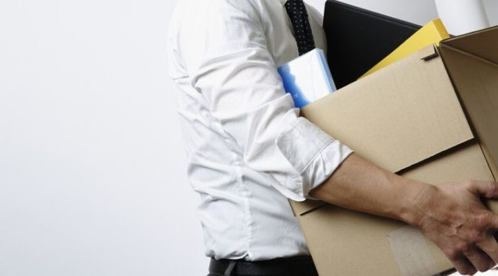 terminated employee carrying a box full of office supplies